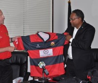 Barrhaven Scottish Rugby Football club present Minister Michael Darville (Minister Grand Bahamas) with a team jersey.