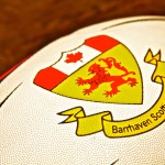 A rugby ball with the logo of the Barrhaven Scottish Rugby Football Club